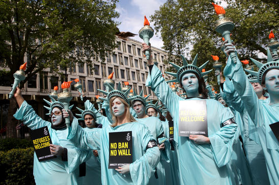 100 Statues of Liberty protest outside the US embassy with Amnesty UK