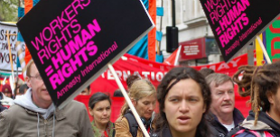 Amnesty activists at a May Day demonstration