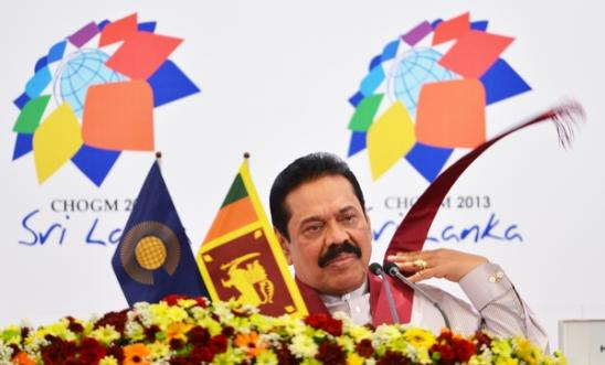 Sri Lanka President Mahinda Rajapaksa listens during a press conference.