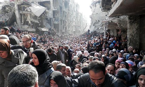 Yarmouk residents wait to receive food aid