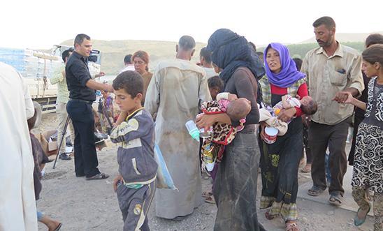 Yezidi IDPs who fled Mount Sinjar arrive in Feshkhabour