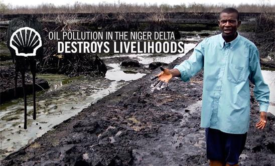 A farmer stands on his oil-covered land in the Niger Delta