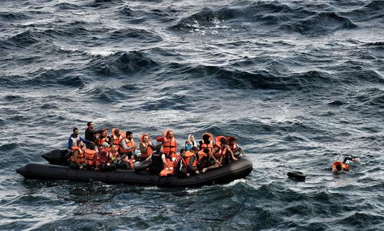 People try to reach the Greek island of Lesbos on 30 September 2015