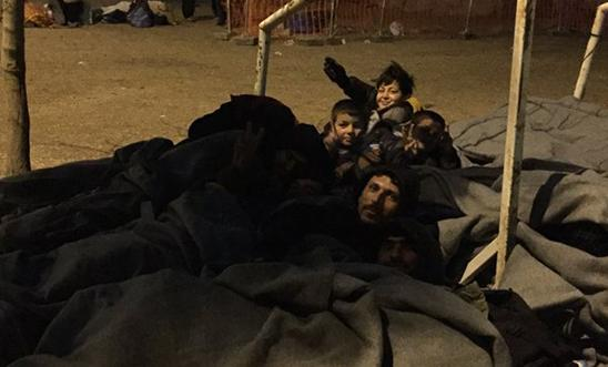 People sleeping outside a petrol station near the Greece/Macedonia border