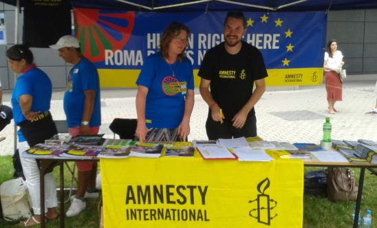 Ulrike Schmidt, Country Coordinator for Eastern Europe running a stall in Poland