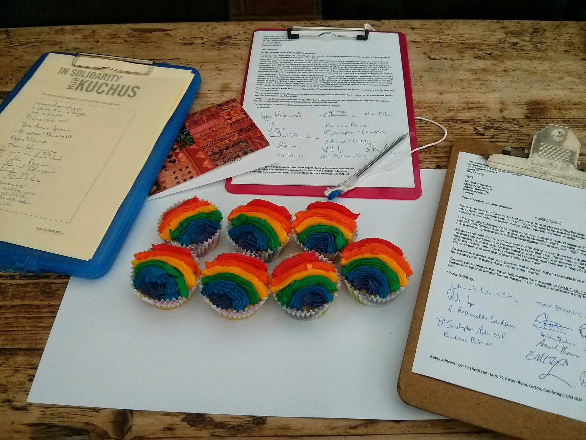 Signing letters and petitions at meetings, and raising funds through a cake sale