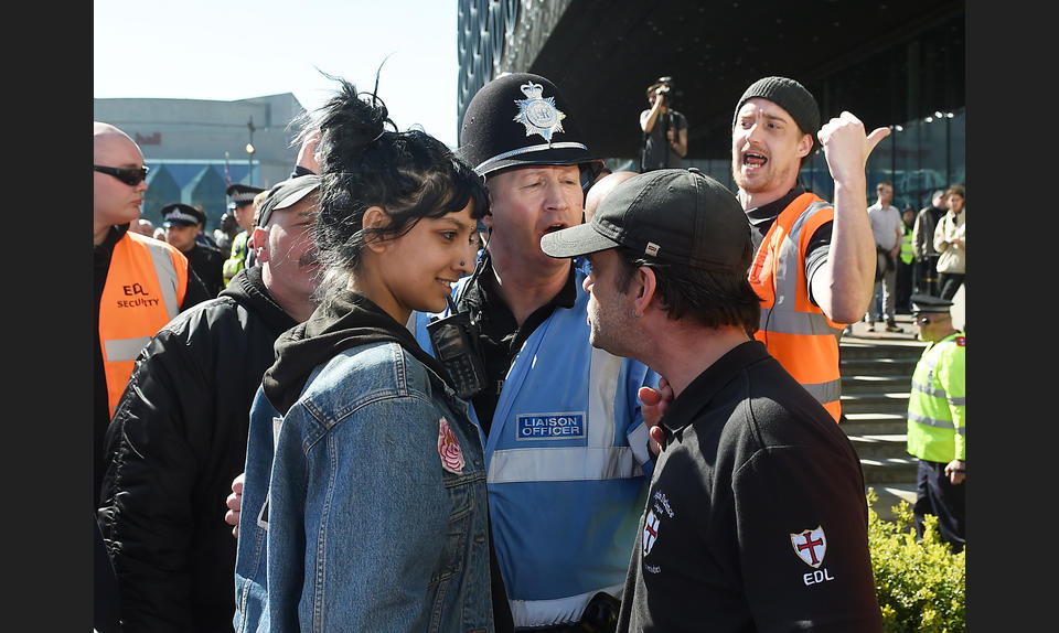In a symbol of defiance, Saffiyah Khan (left) took a stand against English Defence League protester Ian Crossland in Birmingham in April 2017