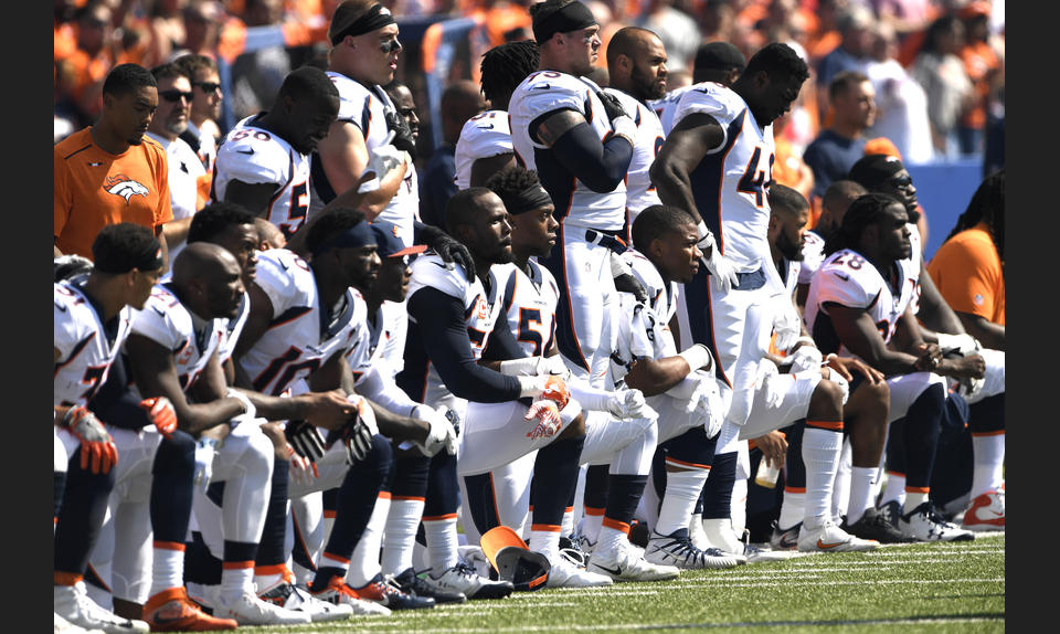 The Denver Broncos kneel before playing against the Buffalo Bills in New York, October 2017