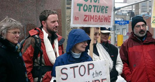 AI Canada protesting against torture in Zimbabwe
