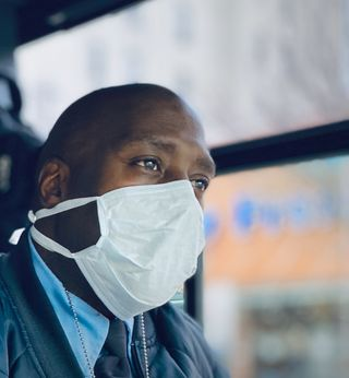 Bus Driver with a mask