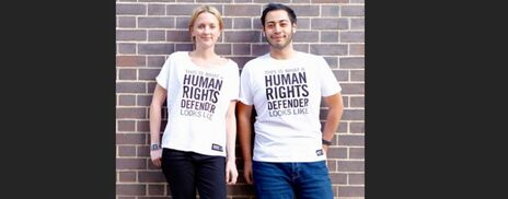Two people modelling Amnesty T-Shirts