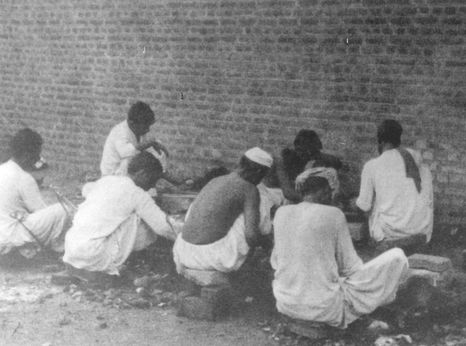 Pakistani prisoners breaking rocks in the prison yard