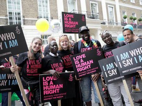 AIUK activists marching at London Pride