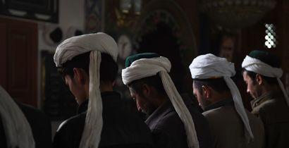 Uyghur men praying in a mosque in Hotan, in China's western Xinjiang region.