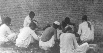 Pakistani prisoners breaking rocks in the prison yard