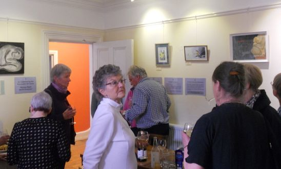People at art exhibition opening