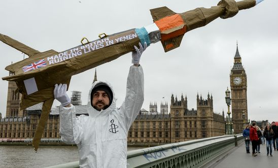 Amnesty International activists march with homemade replica missiles across Westminster Bridge