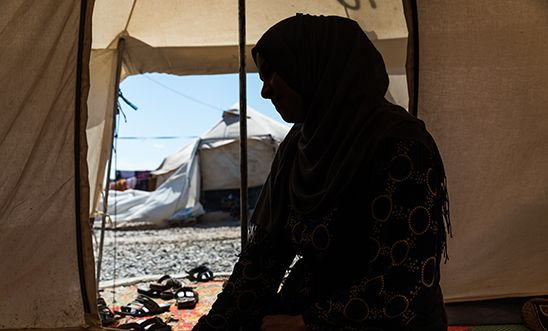 Silhouette of woman in displacement camp in Iraq for perceived ties to Islamic State