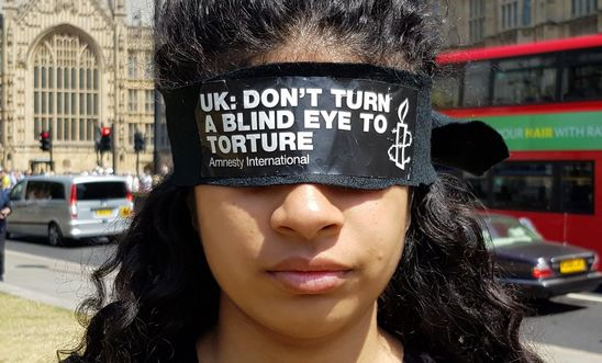 Blindfolded campaigners protest outside Parliament to call for a proper inquiry into UK torture involvement