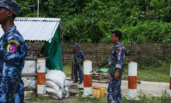 Myanmar border police stand guard at the check point near the entrance of Maungdaw township in Myanmar's Rakhine State