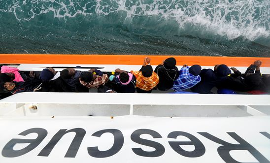 Migrants wait to disembark from Aquarius in the Sicilian harbour of Catania, Italy, May 27, 2018