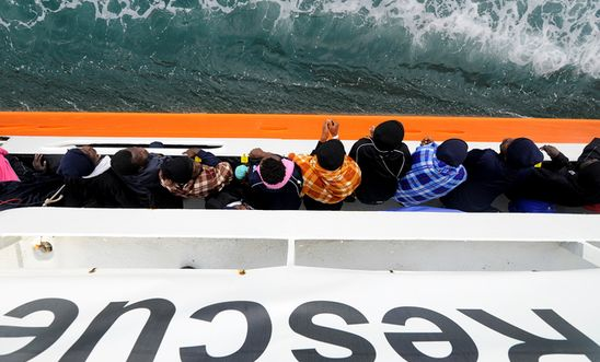 Refugees and migrants wait to disembark from Aquarius in the Sicilian harbour of Catania - May 2018