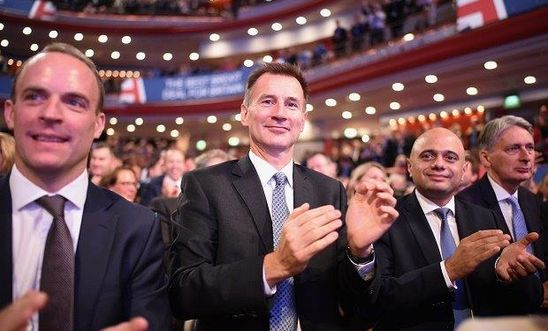Cabinet Ministers (L-R) Dominic Raab, Jeremy Hunt, Sajid Javid and Philip Hammond clap ahead of British Prime Minister Theresa May's speech on the final day of the Conservative Party Conference at The International Convention Centre on October 3, 2018 in Birmingham, England.
