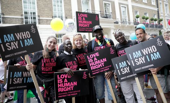 People from Amnesty International's Rainbow Network march at Pride in London.