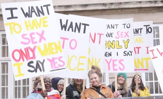 "Women stand together hold placards that read ""I want to have sex only when I say yes"""