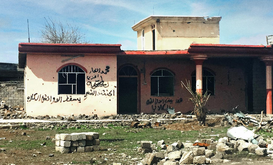 A house daubed with the words 'This is the home of Daesh dogs' in the town of Hammam al-Alil in Ninewa governorate