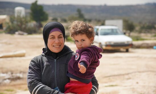 A Palestinian woman and her son in the village of Susiya, occupied West Bank, February 2020. Less than a kilometre away, lies the illegal Israeli settlement of Susya.