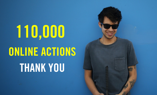 Image of Gustavo Gatica standing in front of a blue wall with '110,000 online actions thank you' text