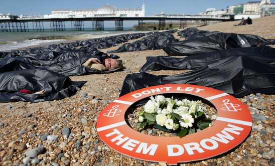 SOS Europe - Die-in, Brighton Beach, England.