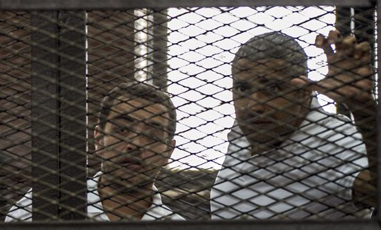 Baher Mohamed and Mohamed Fahmy at a court hearing in 2015