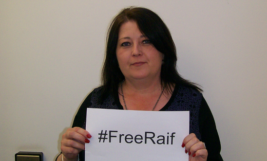 Local Group member of North Herts Group holding up FreeRaif hashtag