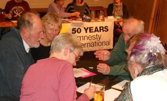 The 2014 Amnesty quiz showing the quiz organisers and one of the teams