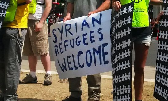 Syrian Refugees Welcome Sign