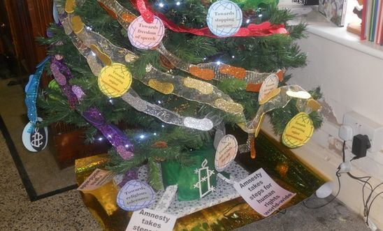 Tree with footprint decorations and AI slogans