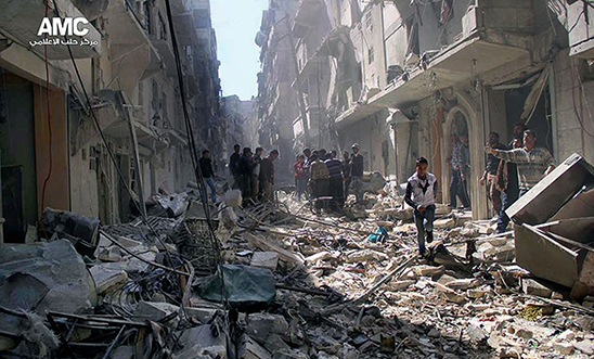 Syrians inspect the rubble of destroyed buildings