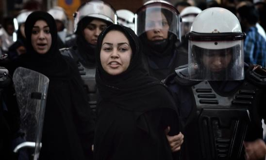 A Bahraini protester detained by riot police