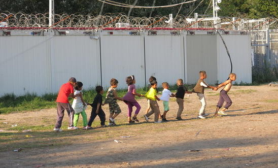 Children making the most of things in a refugee camp