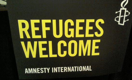 Refugees welcome Amnesty banner
