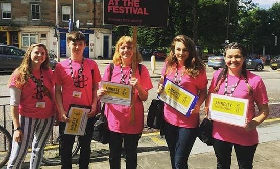 Amnesty staff campaigning at FestVols