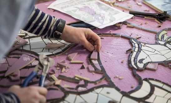 Artist Carrie Reichardt working on the ceramic mural entitled 'Suffragette Spirit' at her studio in West London
