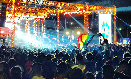 Rainbow flag being raised at a Mashrou' Laila concert in Cairo, Egypt on 22 September 2017