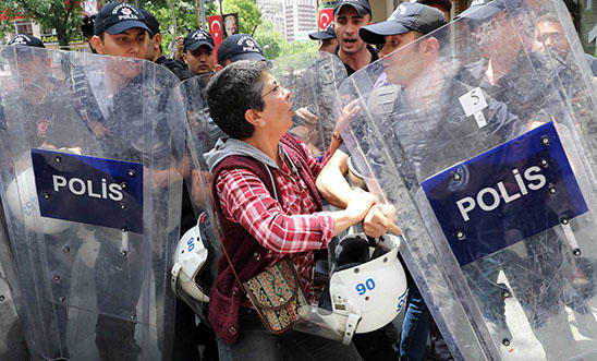 Riot police intervene to stop protesters demonstrating