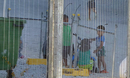 Children playing near the Refugee Processing Centre on Nauru