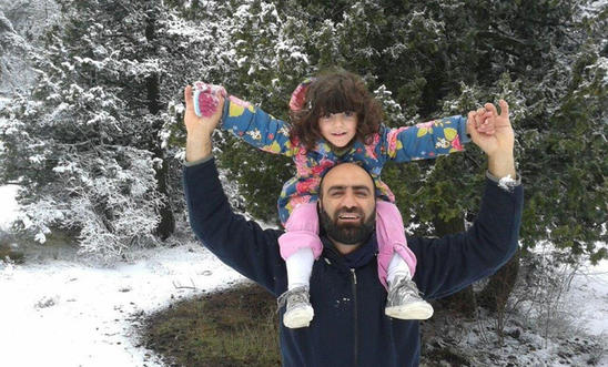 Ahmed H with his daughter