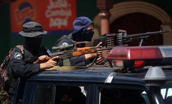 Members of the National Police armed with Dragunov riffle and a PKM machine gun in Masaya