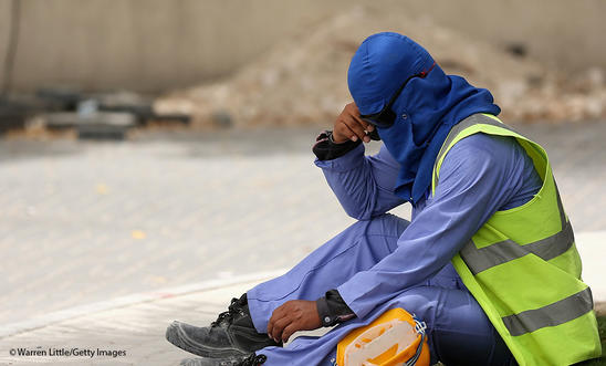 A construction worker takes a break from a building site in Doha, Qatar.